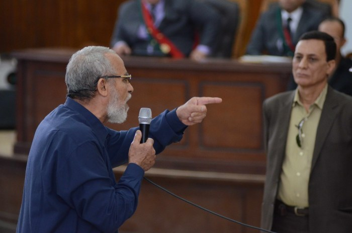 Egyptian Brotherhood's supreme guide Mohamed Badie (C) gestures as he talks to his judges during his trial in the capital Cairo on May 18, 2014.