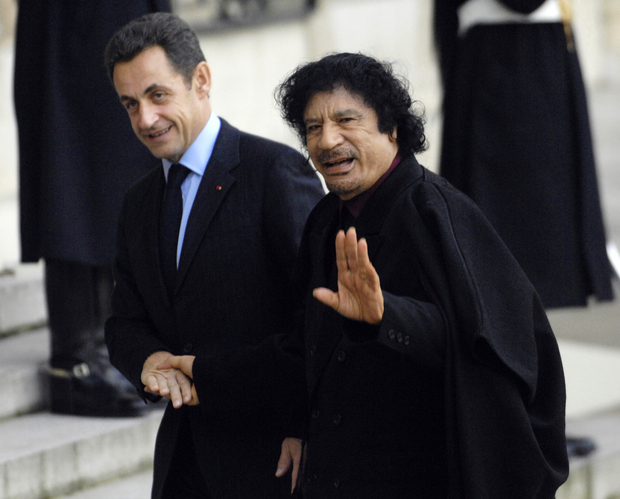 "Former French President Nicolas Sarkozy (L) greets Libyan leader Moamer Kadhafi, 12 December 2007, at the Elysee Palace in Paris, before their meeting. Sarkozy came under renewed pressure ahead of a meeting with Moamer Kadhafi, as the opposition charged he had fallen into a ""trap"" by inviting the Libyan leader to Paris. AFP PHOTO STEPHANE DE SAKUTIN"